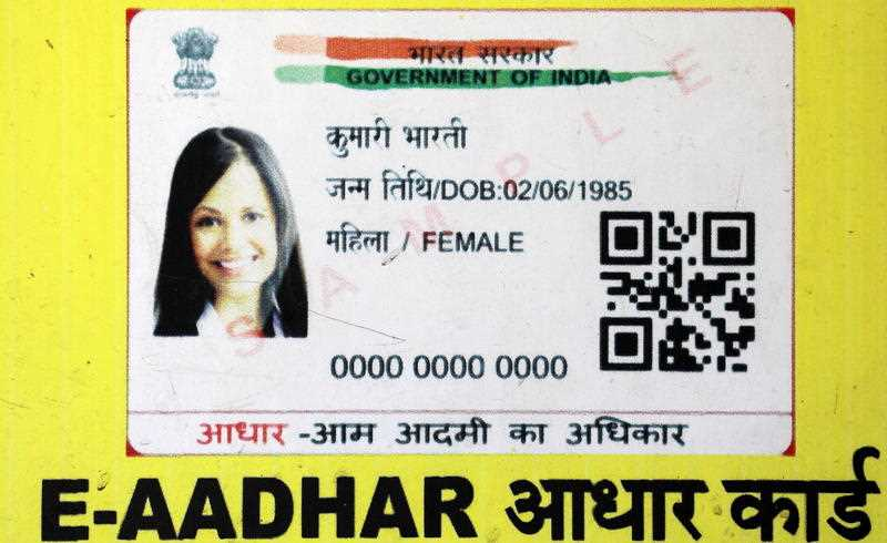 A close up view of a sample of an Aadhaar card.