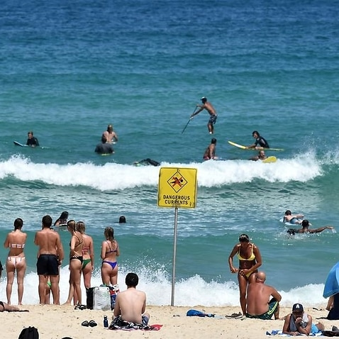 Beachgoers and surfers are seen at Bondi Beach (file image)