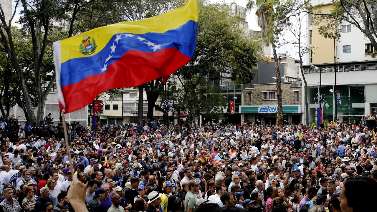 People attend a public event where Head of the Venezuelan Parliament, Juan Guaido spoke in the east of Caracas, Venezuela, 25 January 2019.