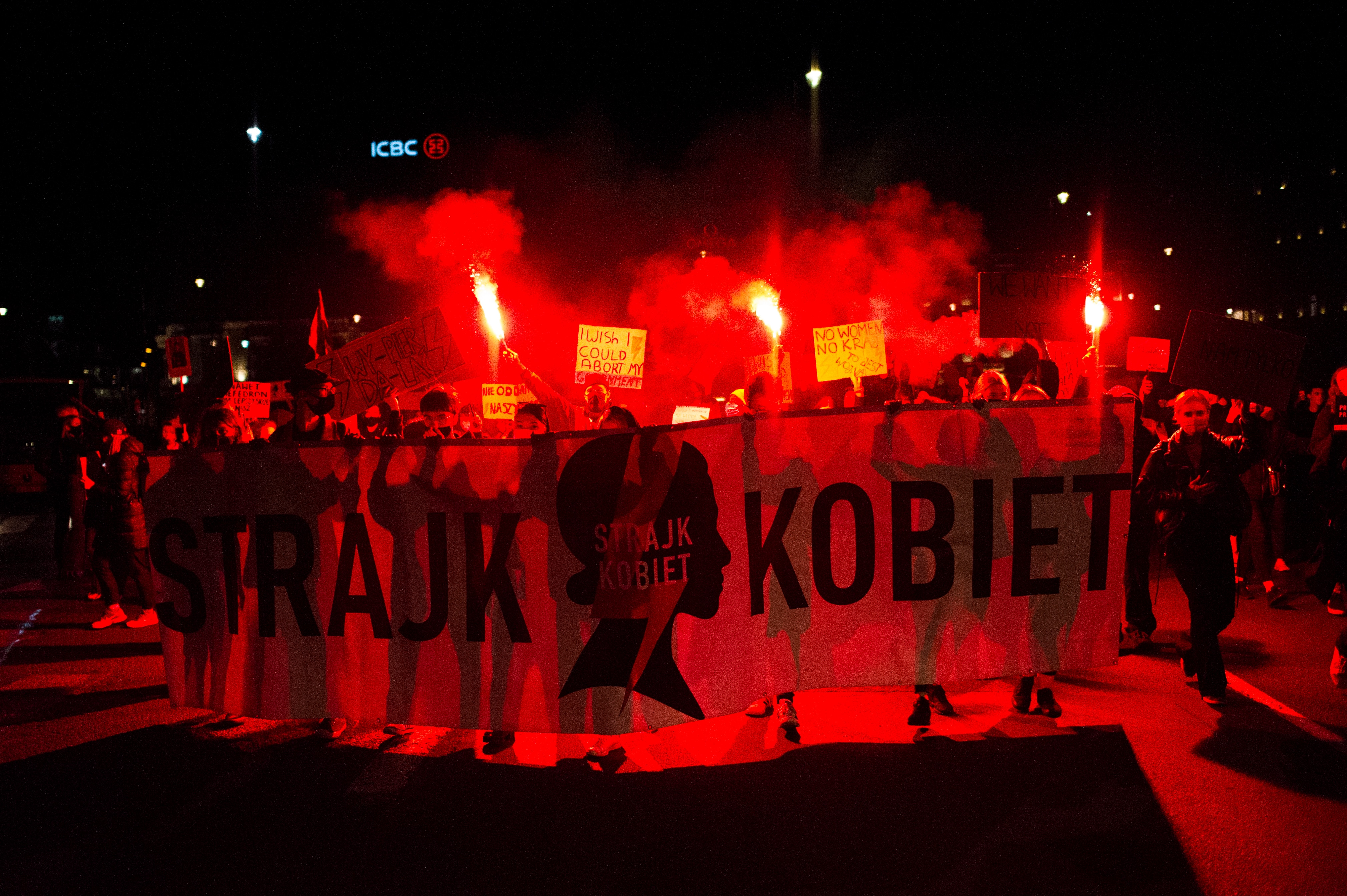 People protest in Warsaw, Poland, on 26 October.