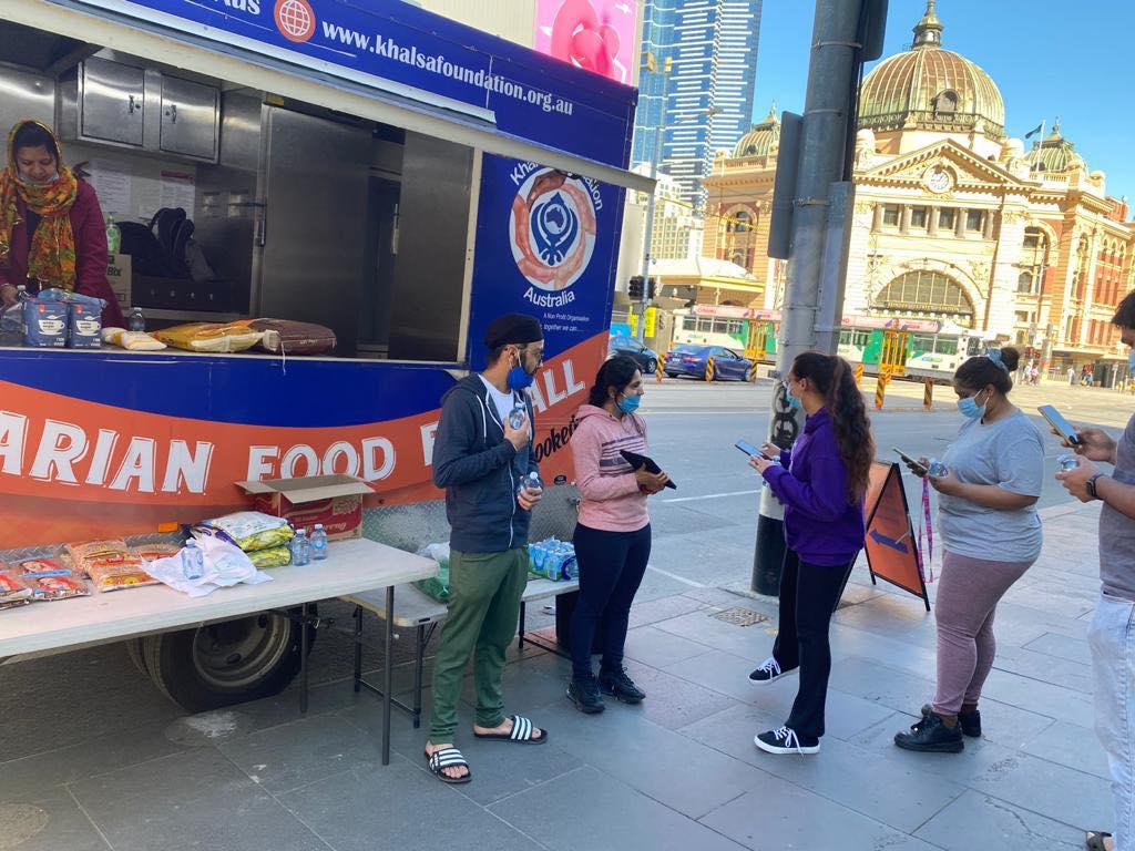 Khalsa Foundation serving free food near Flinders Street Station, Melbourne.