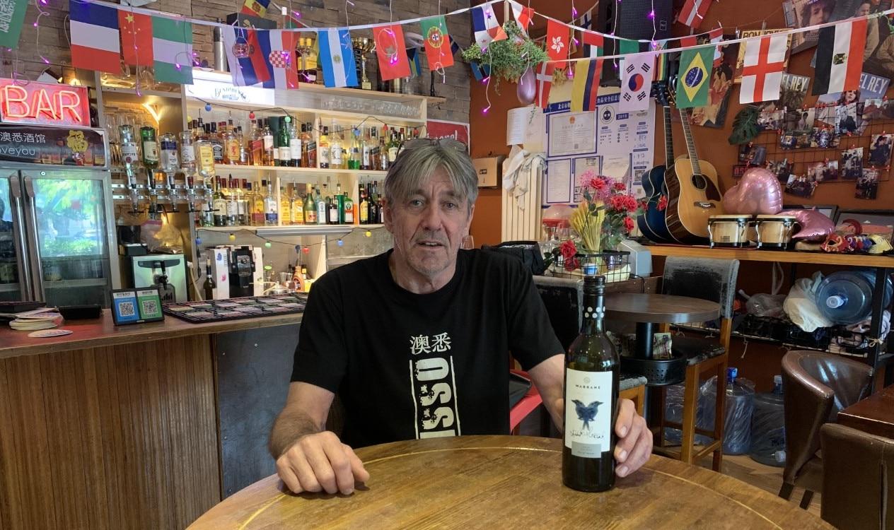 Queenslander Steve Goodey serves Australian wine at his bar in Beijing.