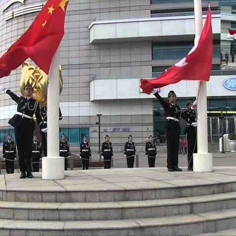 Flag-raising ceremony at Golden Bauhinia Square, and the Convention and Exhibition Centre.