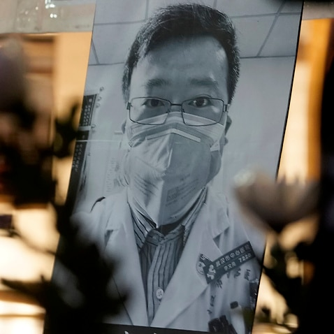 A photo of Chinese doctor Li Wenliang as people attend a vigil in Hong Kong, Friday, Feb. 7, 2020.