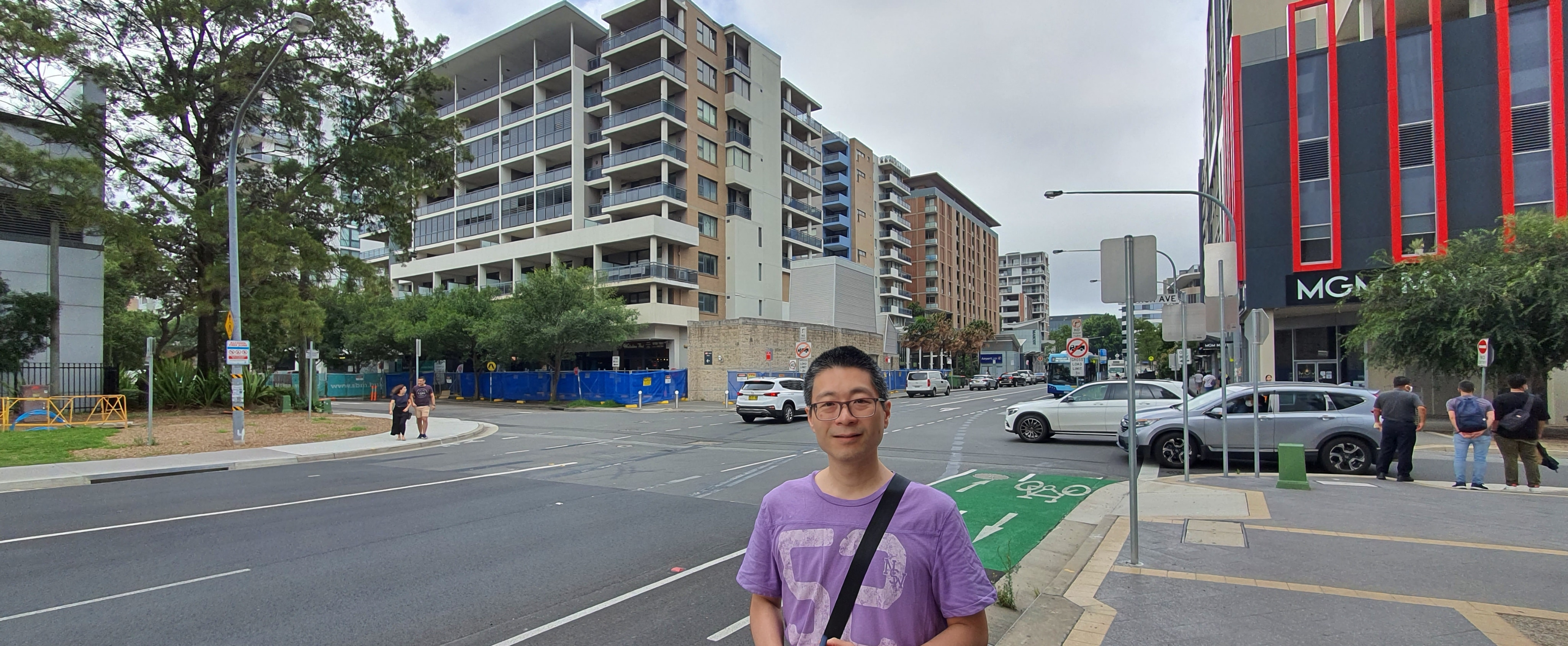 Alex Chan in front of the Mascot Towers building.