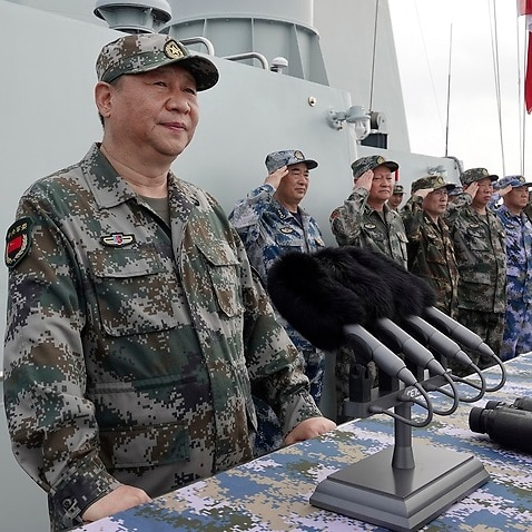 Chinese President Xi Jinping in the South China Sea. China has announced live-fire military exercises in the Taiwan Strait.
