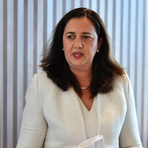 Annastacia Palaszczuk is seen leaving a press conference.