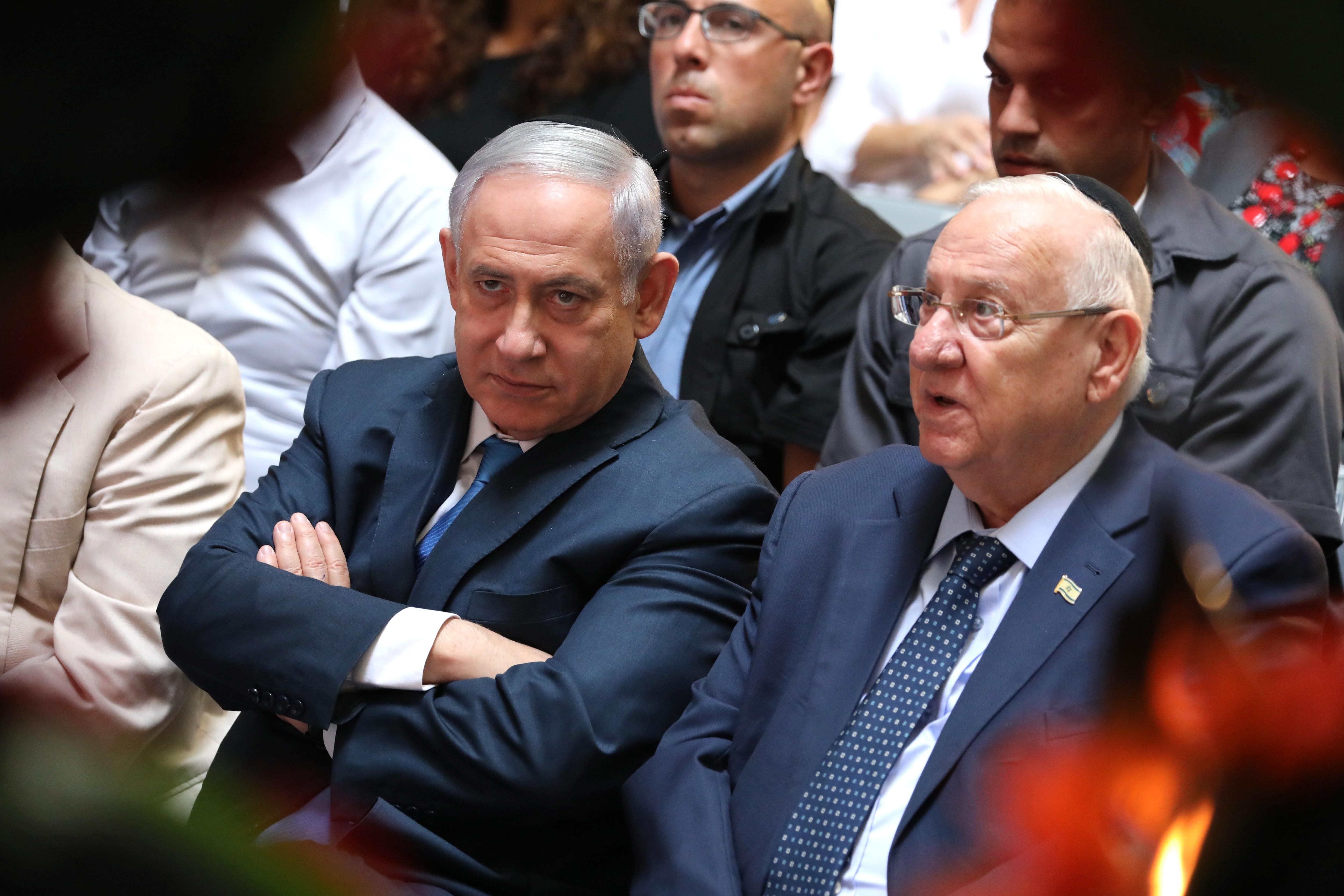 Israeli Prime Minister Benjamin Netanyahu (left) and Israeli President Reuven Rivlin. Mr Rivlin says he will ask Gantz to try to form government.