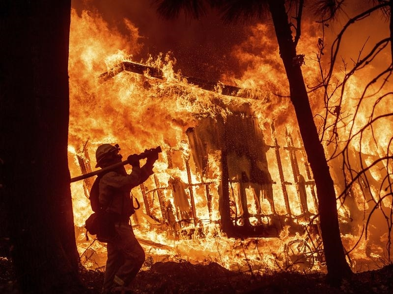 A firefighter battles the Camp Fire in California.