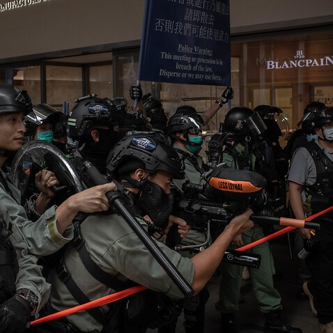 Riot police agents fire pepper bullets at protesters during Wednesday's demonstration in Hong Kong.