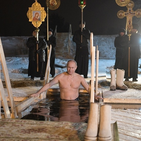 Russian President Vladimir Putin takes a dip in the ice cold water of the lake Seliger during the celebrations of the Orthodox Epiphany holiday
