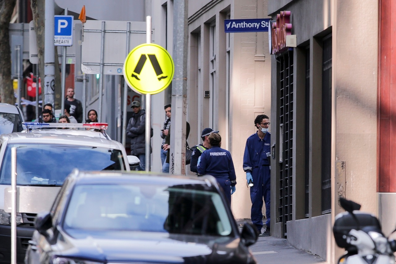 Police investigate a crime scene at the EQ Arcade building on A'Beckett Street in Melbourne, Saturday, July 21, 2018. A woman has died from injuries following an incident in a Melbourne CBD apartment. (AAP Image/Wayne Taylor) NO ARCHIVING