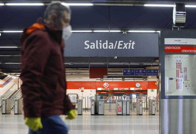 A commuter walks through Nuevos Ministerios Metro station in Madrid