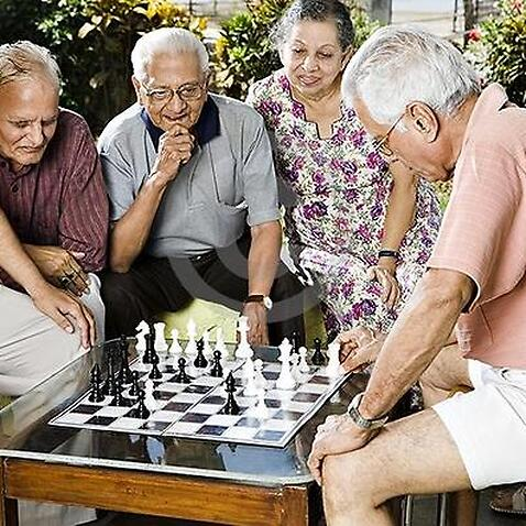 Older residents enjoying a game of chess