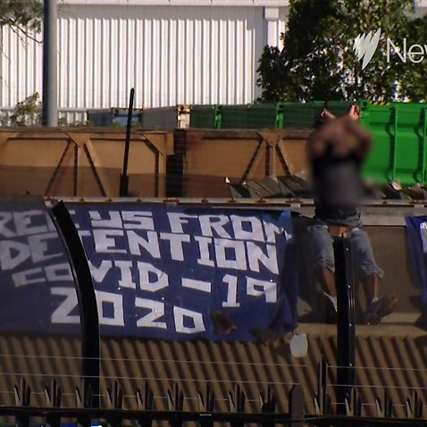 Asylum seekers at Sydney's Villawood detention centre have climbed onto the facility's roof to call for their release amid fears about the spread of COVID-19.