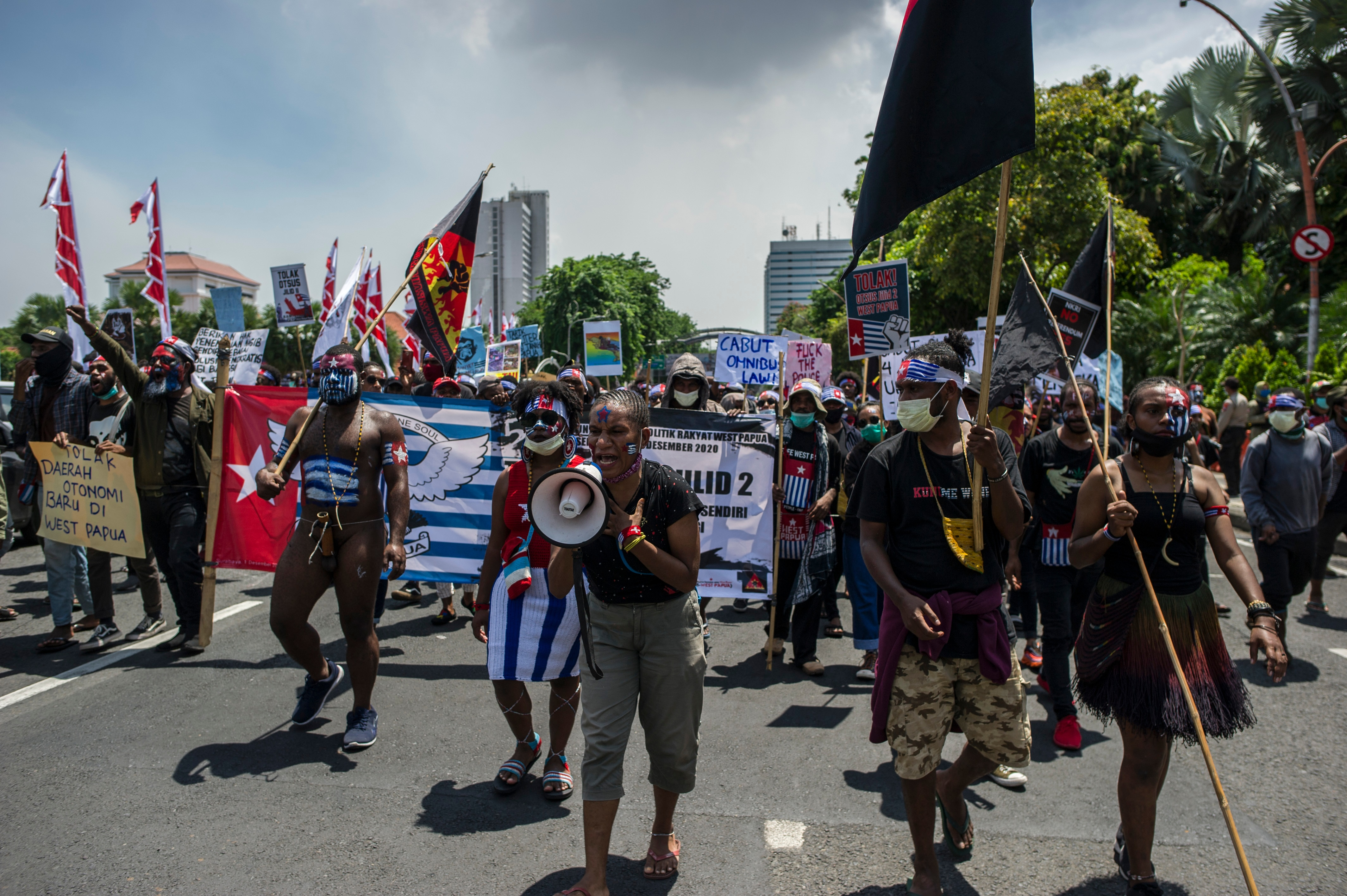Hundreds of Papuans held rallies across at least eight cities in Indonesia on Tuesday to renew calls for independence.