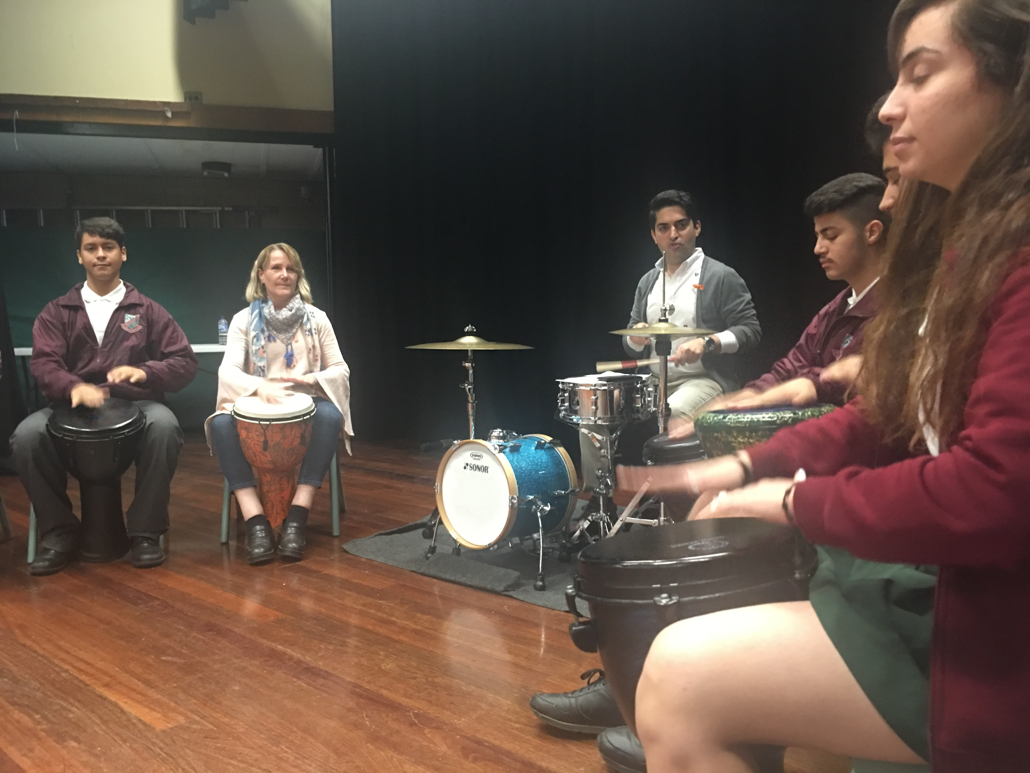 Evan Yako teaches drumming to newly arrived migrants and refugees.