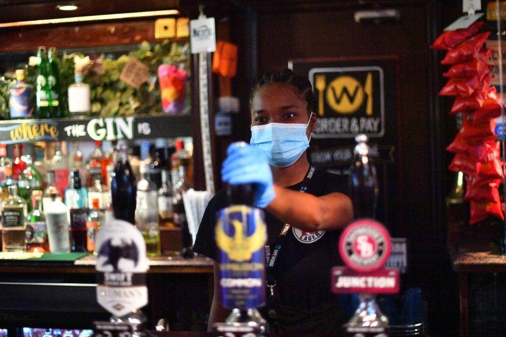 Pubs reopen across England.