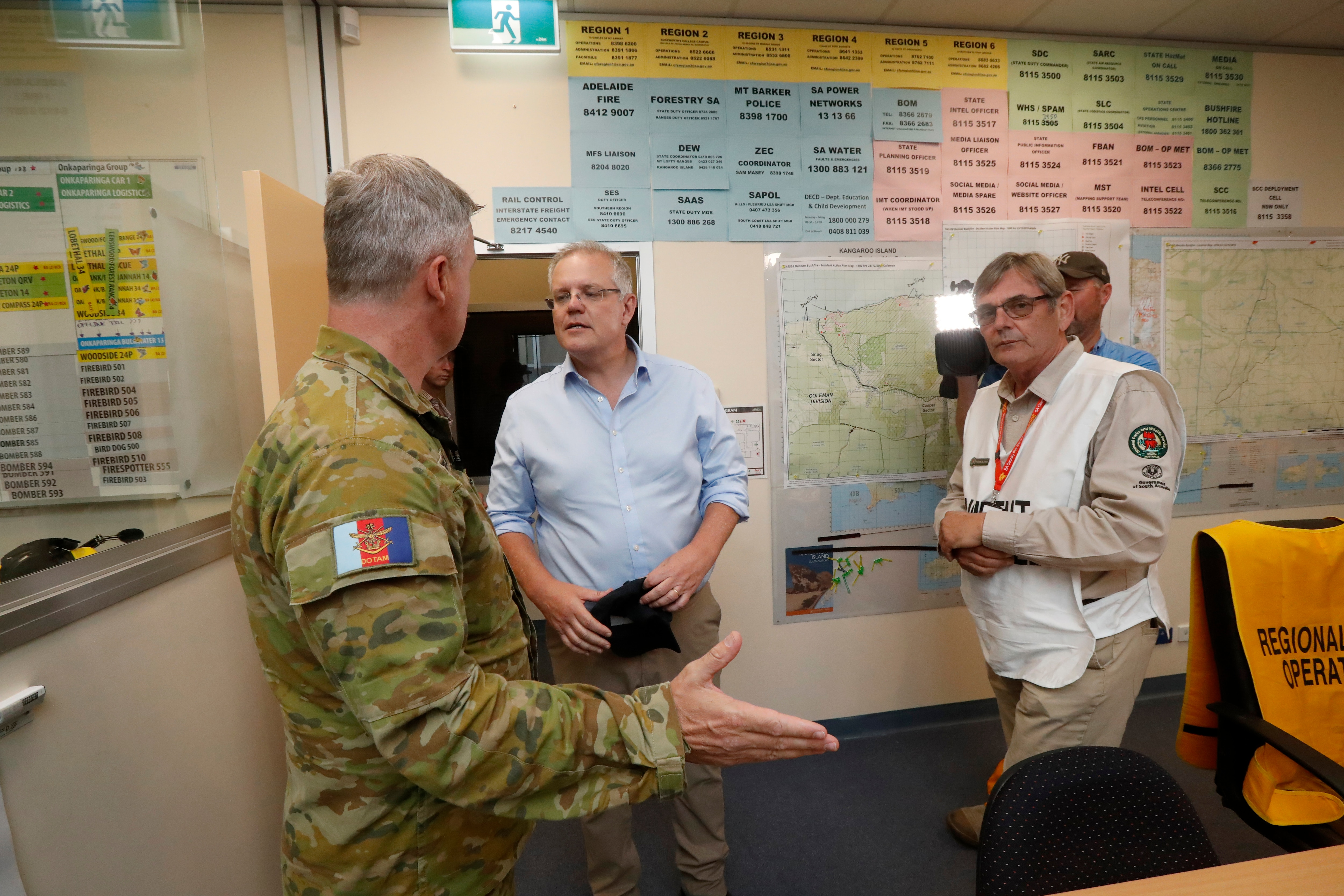Prime Minister Scott Morrison is briefed by CFS volunteers and the military at the Mt Barker CFS HQ in Mount Barker.