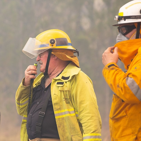 Firefighters are seen near fires at Lake Cooroibah Road and Jirrimah Crescent in Cooroibah in Noosa Shire, Queensland, Saturday, 9 November, 2019.