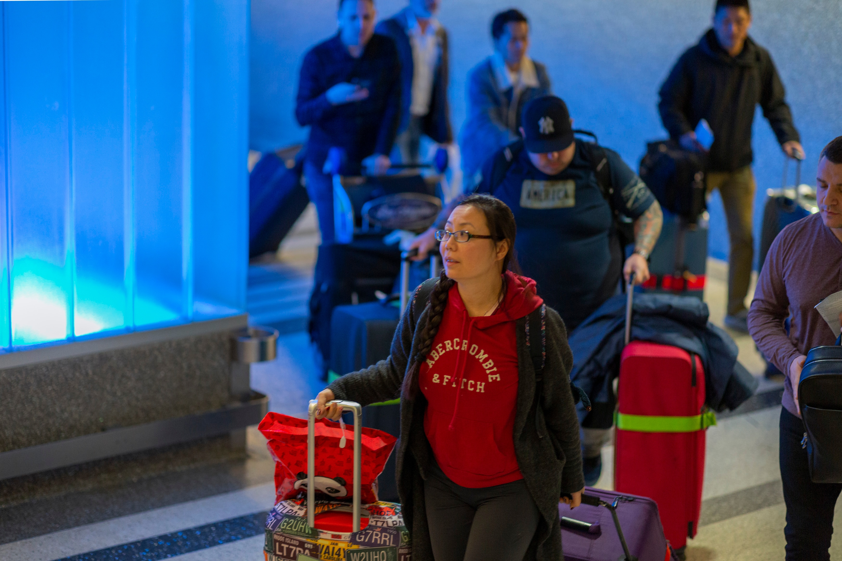 Travellers arrive at Los Angeles International Airport after touching down on an Air China flight from Beijing.