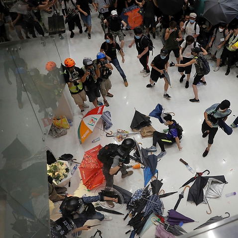 Police in Hong Kong have fought with protesters as they broke up a demonstration by thousands of people.