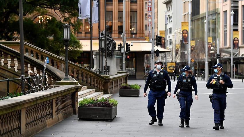 NSW Police patrol George Street in Sydney's CBD on Tuesday, 20 July, 2021.