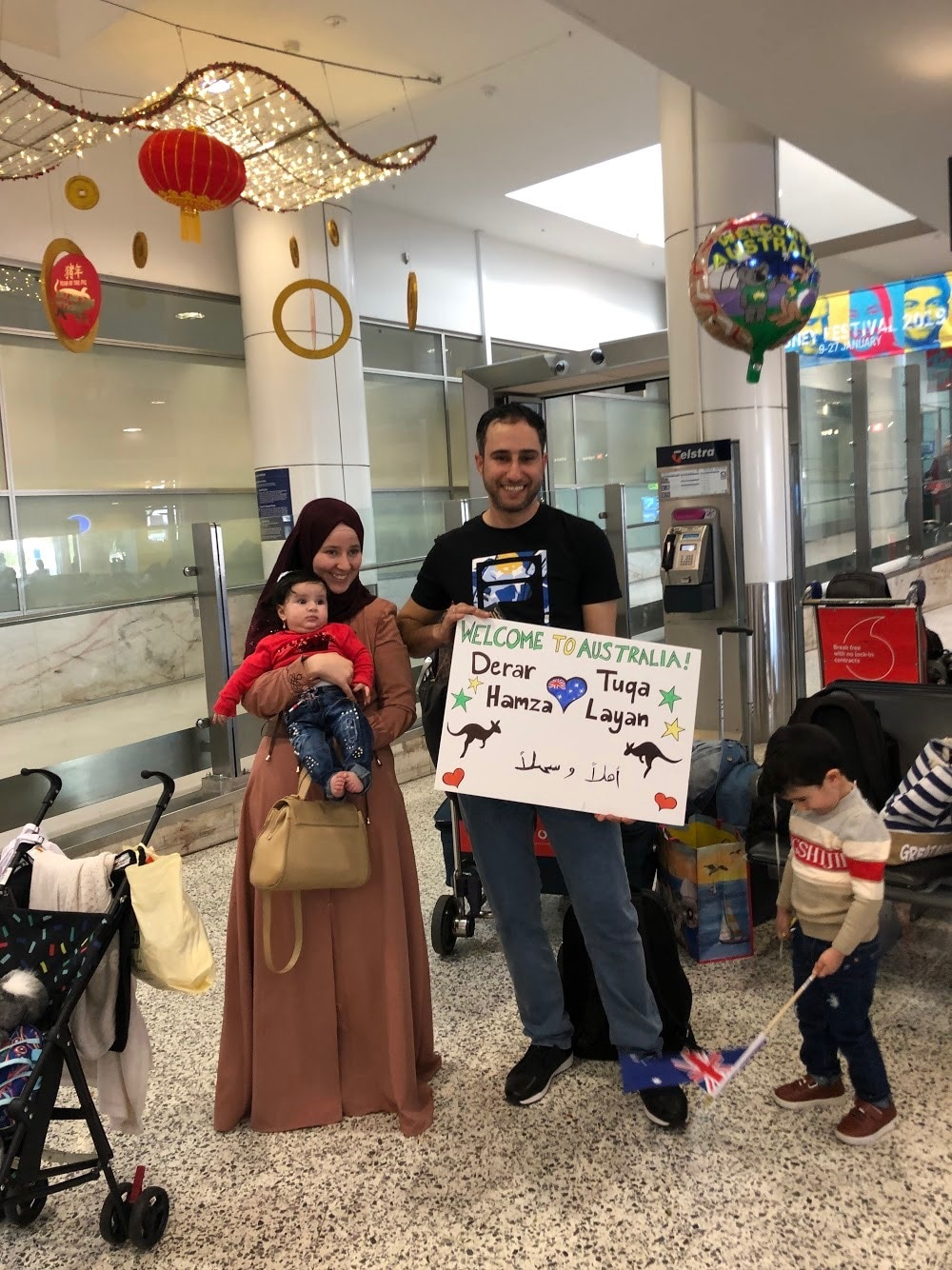Derar and his family arrive at Sydney airport.