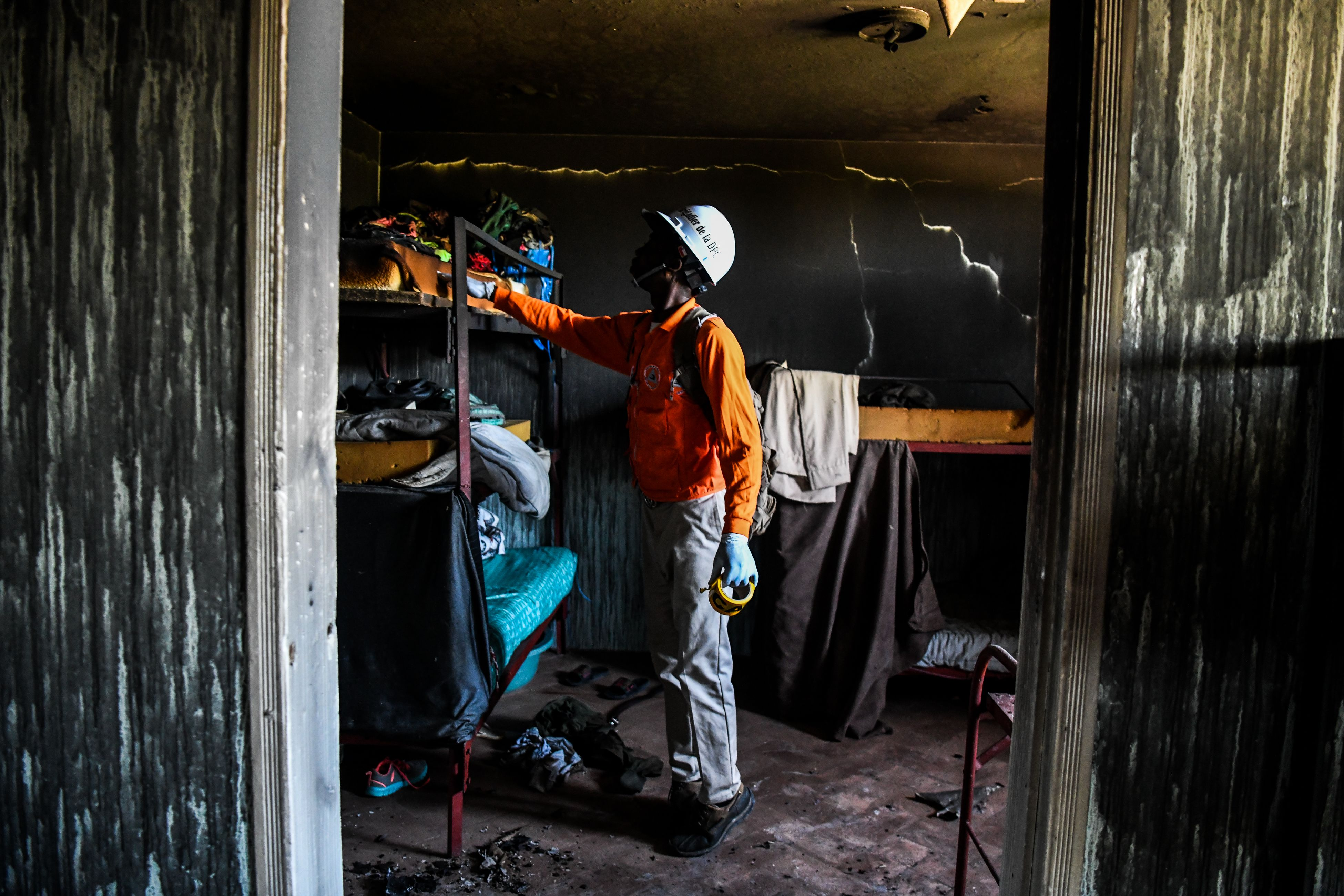 A fireman inspects a room inside the Orphanage of the Church of Bible Understanding.