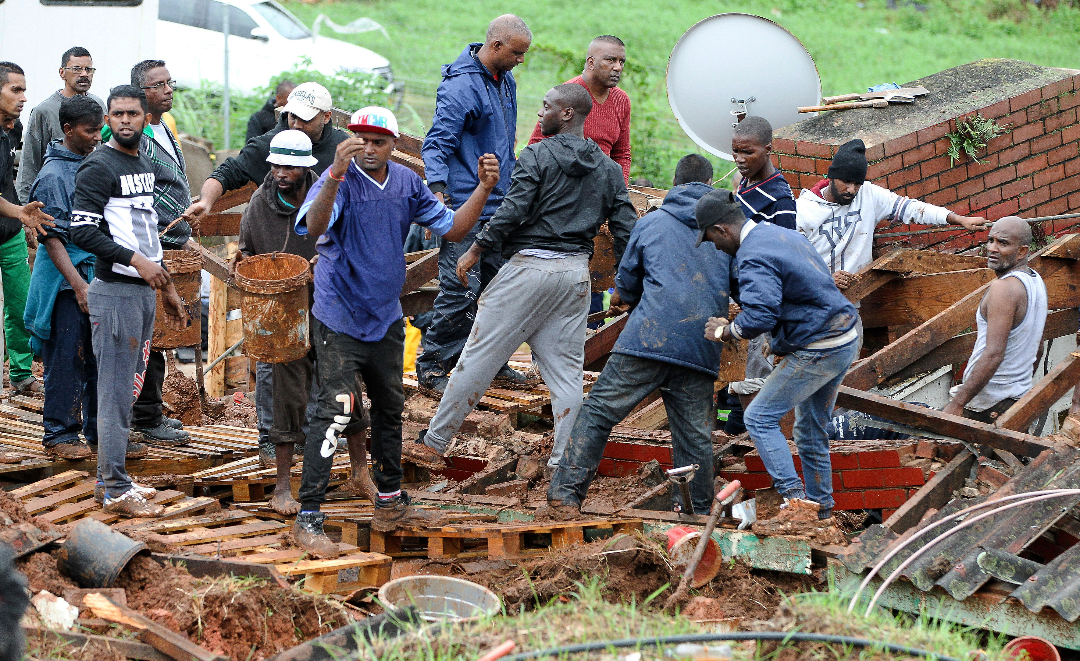 Rescue workers search for bodies in a collapsed building near Durban in South Africa.