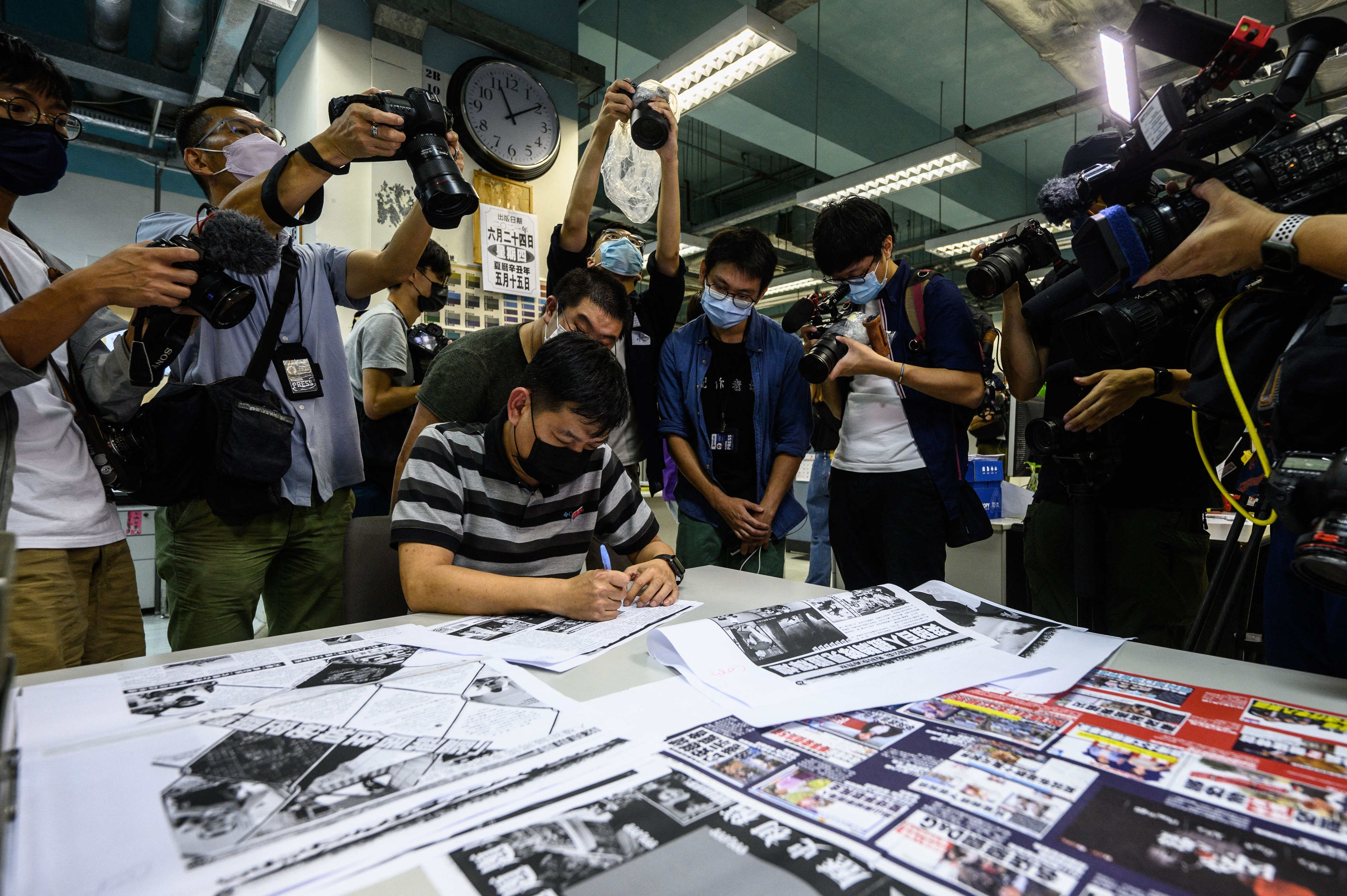 Editor in chief Lam Man-Chung proofreads the next day's 'Apple Daily' newspaper before it goes to print for the last time in Hong Kong, on 23 June.