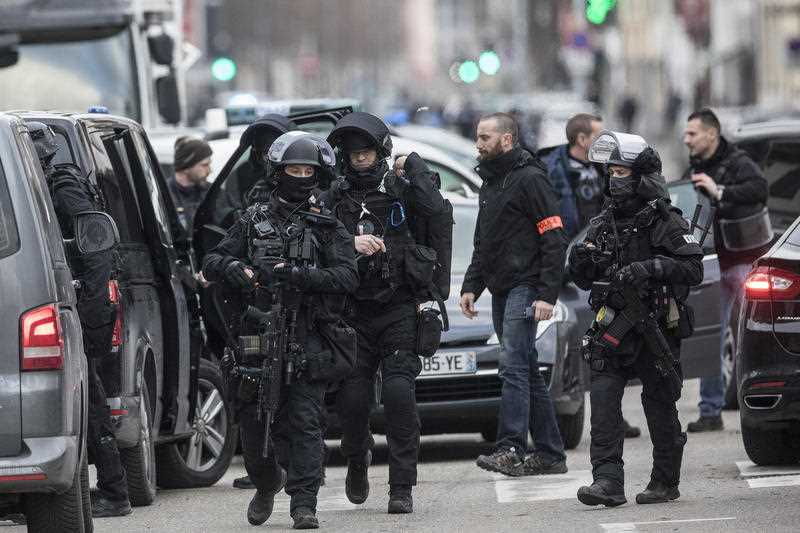French police forces take position in the Neudorf district of Strasbourg, eastern France, Thursday, Dec. 13, 2018.