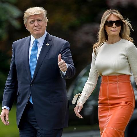 President Donald Trump, accompanied by first lady Melania Trump