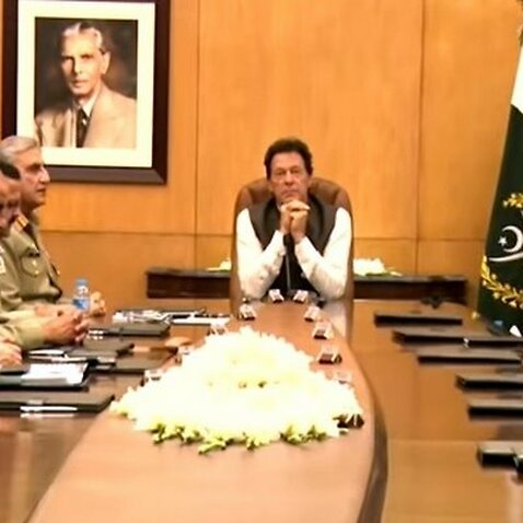 File photo of Pakistan PM Imran Khan holding a meeting of military and other officials