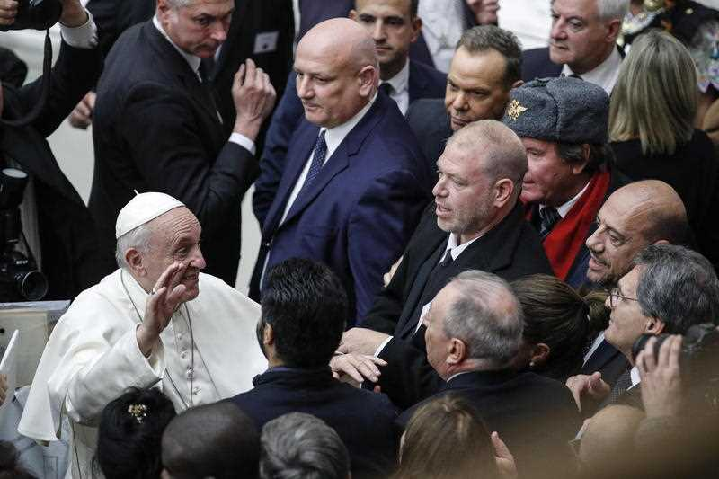 Pope Francis greets the faithful during his weekly general audience in the Paolo VI Hall at the Vatican.