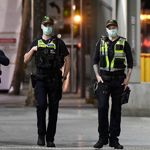 Protective Service Officers patrol Swanston street before a citywide curfew is introduced in Melbourne, Sunday, 2 August, 2020.