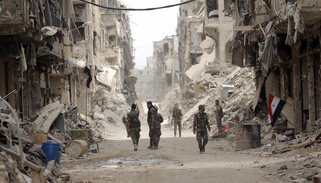 Syrian soldiers patrol at the Yarmouk Camp district in south Damascus in 2018.