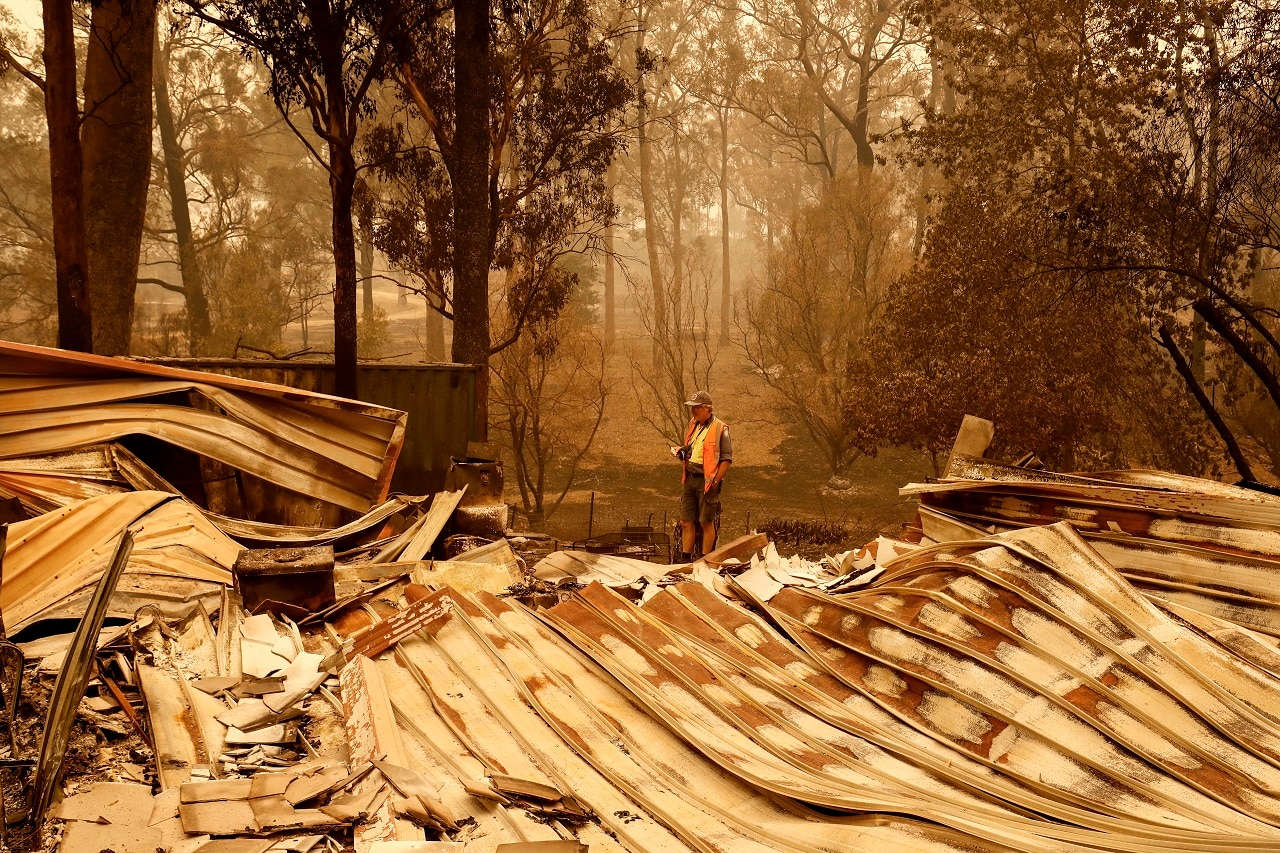 Sarsfield resident Wayne Johnston inspects damage to his property on 3 January.