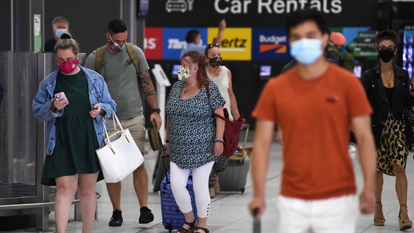 People wearing face masks are seen at Melbourne airport.