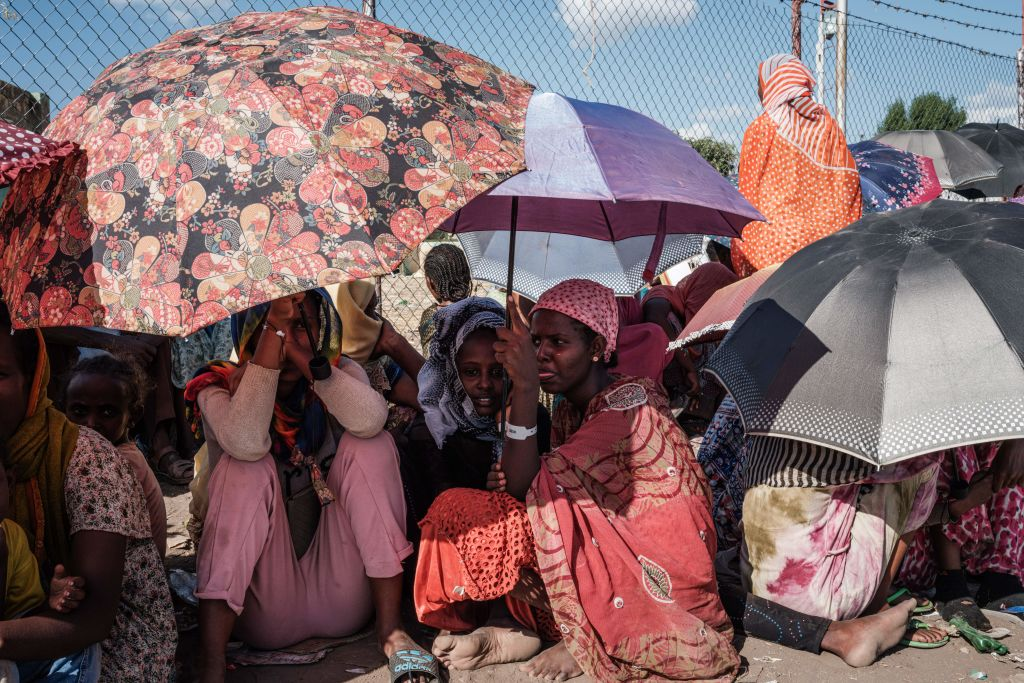 Ethiopian refugees who fled the Ethiopia's Tigray conflict wait for charity contributions at the Border Reception Centre in Hamdayit, eastern Sudan.