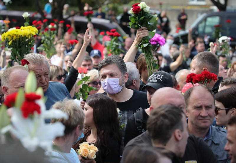 People attend a funeral ceremony for Alexander Tarakhovsky, in Minsk, Belarus, 15 August 2020.