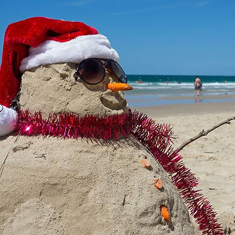 File image from 2014: A Christmas Day celebration on the beach in Sydney.