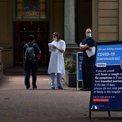 Staff wearing face masks outside the Royal Prince Alfred Hospital (RPA) in Camperdown, Sydney.