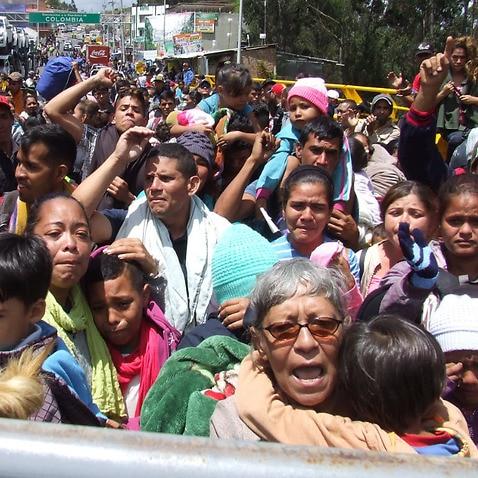Venezuelan migrants at the border between Colombia and Ecuador