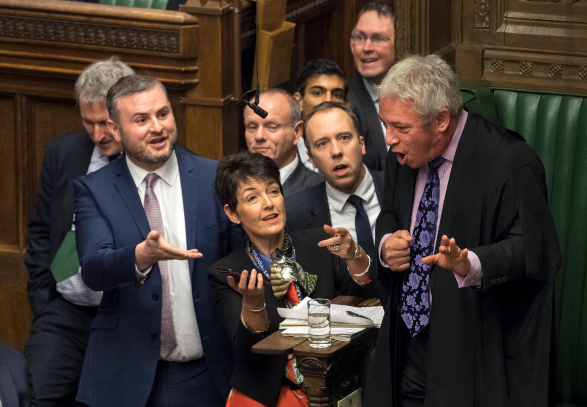 Members of Parliament gather near the Commons Speaker John Bercow urging him to review a video clip of Jeremy Corbyn
