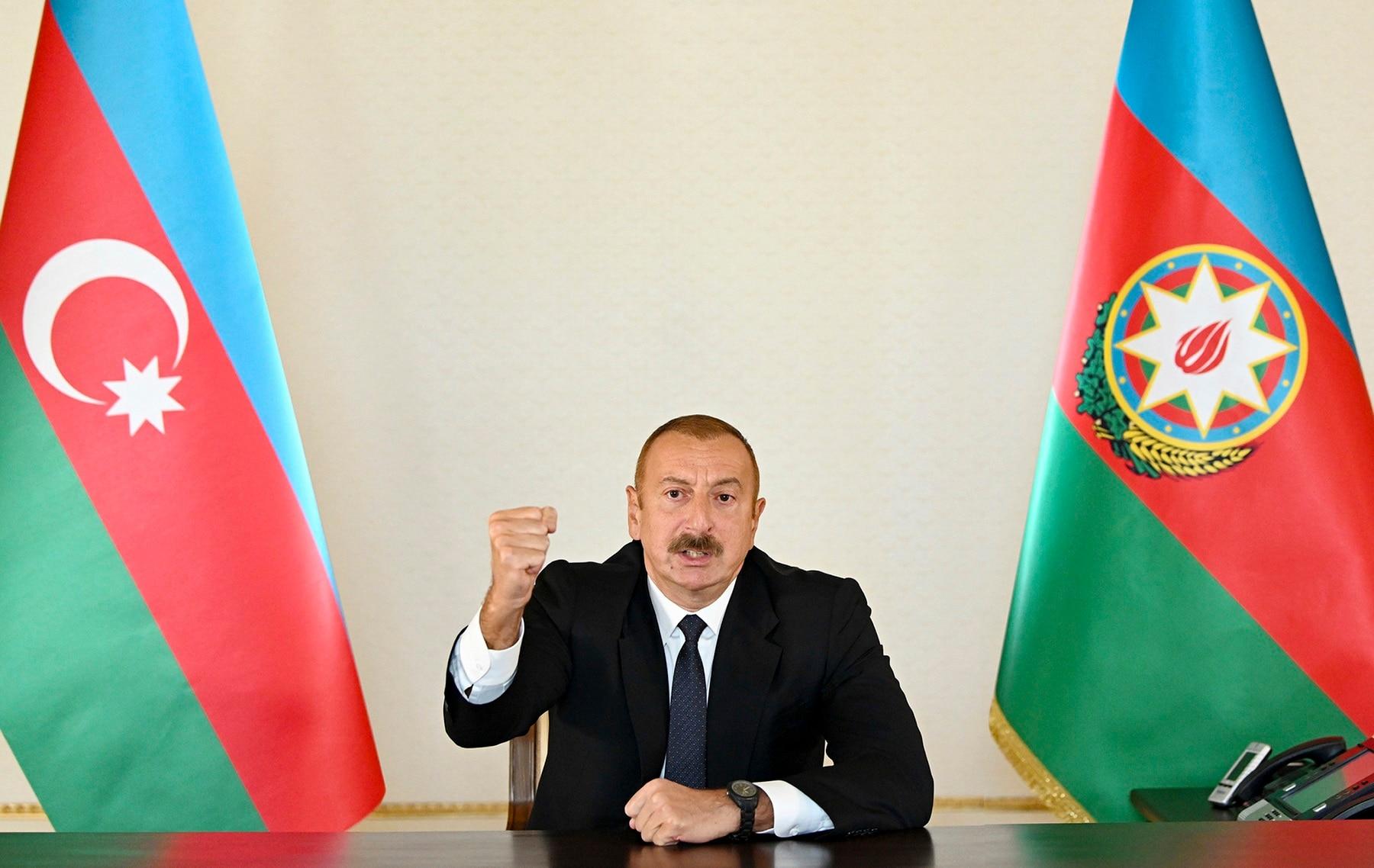 Azerbaijani President Ilham Aliyev gestures as he addresses the nation in Baku, Azerbaijan.