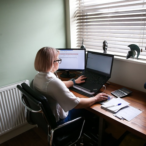 An account manager works from a converted home office during the Coronavirus pandemic.
