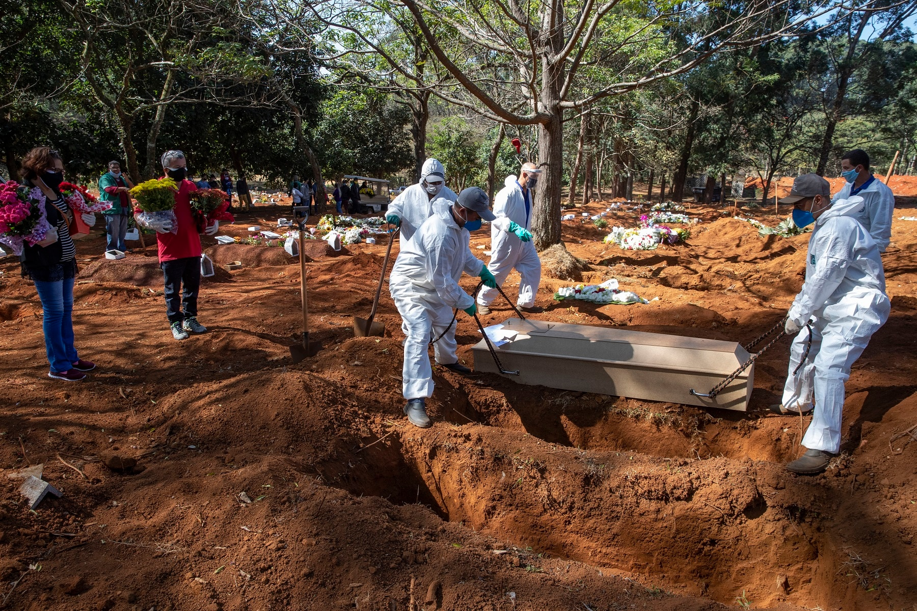Cemetery workers in protective clothing bury the bodies of COVID-19 victims at the Vila Formosa cemetery in Sao Paulo, Brazil.