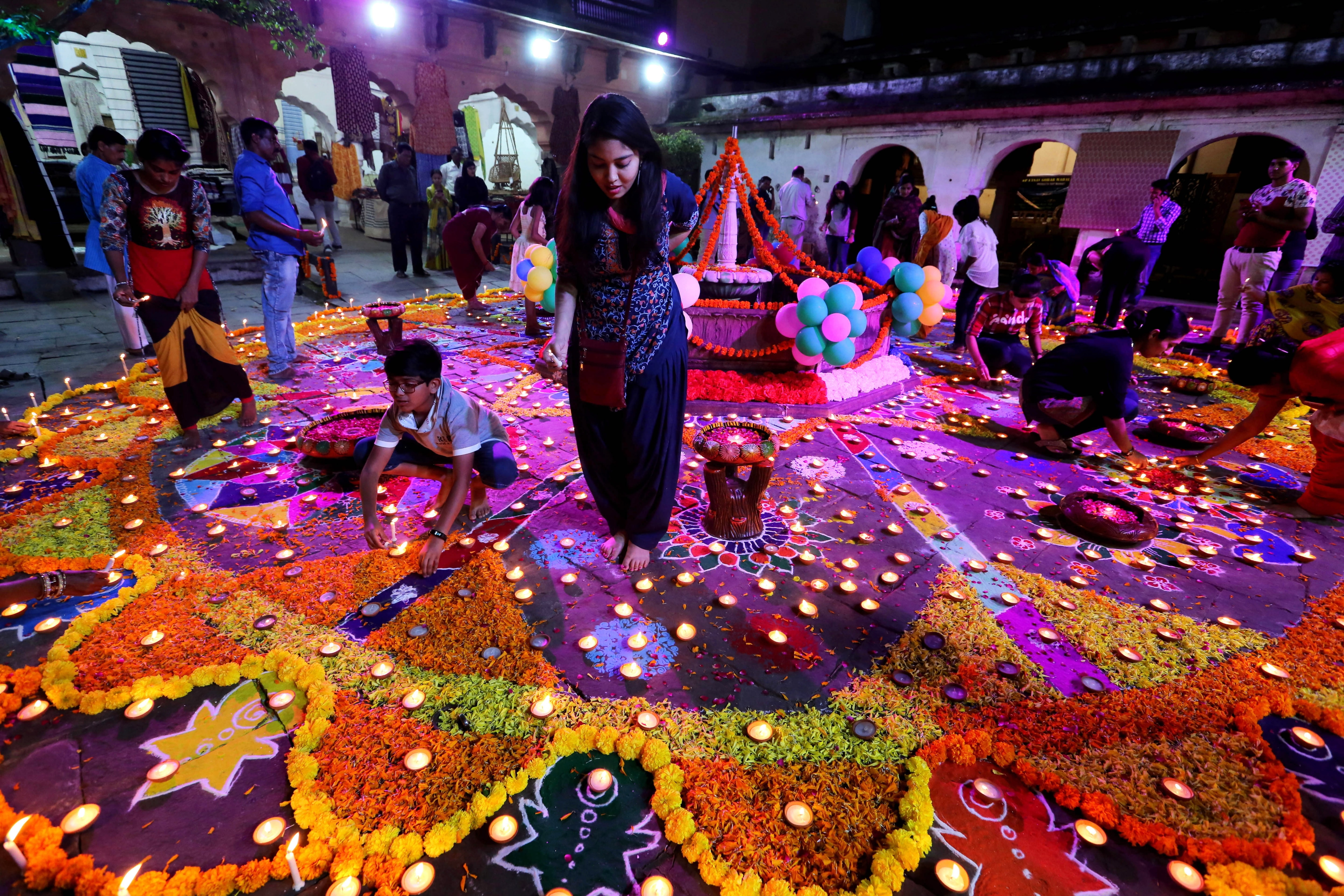 Indian people light oil lamps during the Light Festival as part of the Diwali festival celebrations in Bhopal, India.