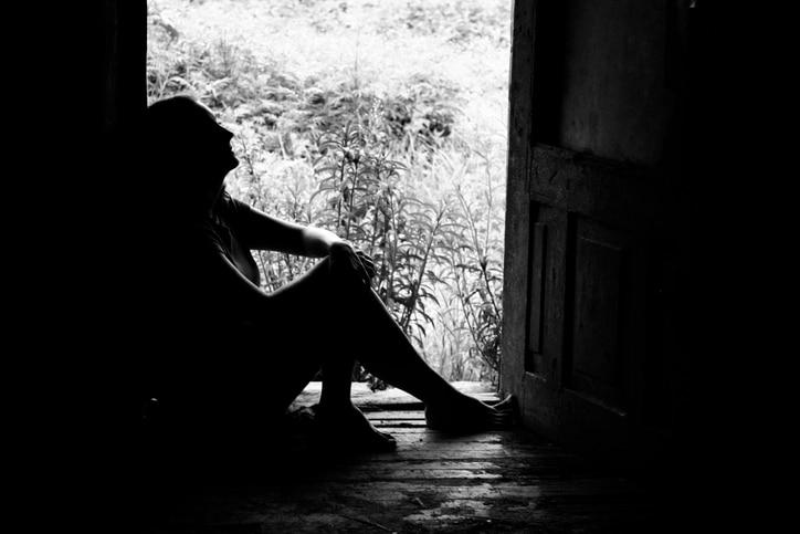silhouette of a woman in doorway (shot in b/w)